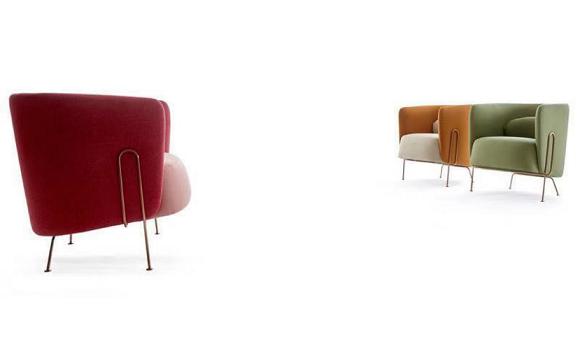 曲别针单椅有多种颜色可供选择。明媚粉红、耀眼橙黄和沉静绿等。